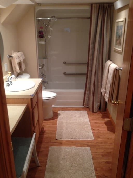 Full bath with tub shower, special sit down vanity, and all toiletries including sunscreen, soaps, hair dryer, towels, brand new packaged toothbrushes if you forgot yours.