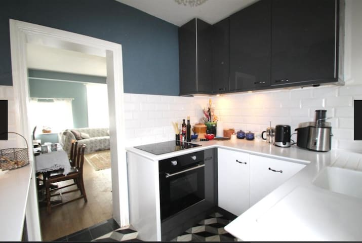 Fully functioning and recently renovated kitchen with cooker, dishwasher, freezer and fridge .