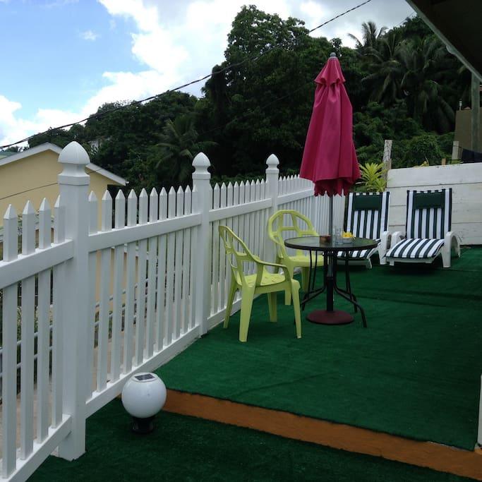 Terrace with sun lounger , umbrella