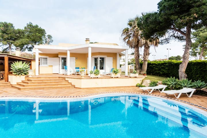 Big Villa with pool in front of Cala Blanca Beach