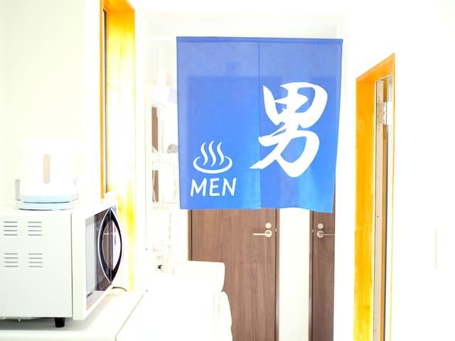 Toilet and shower room for men.