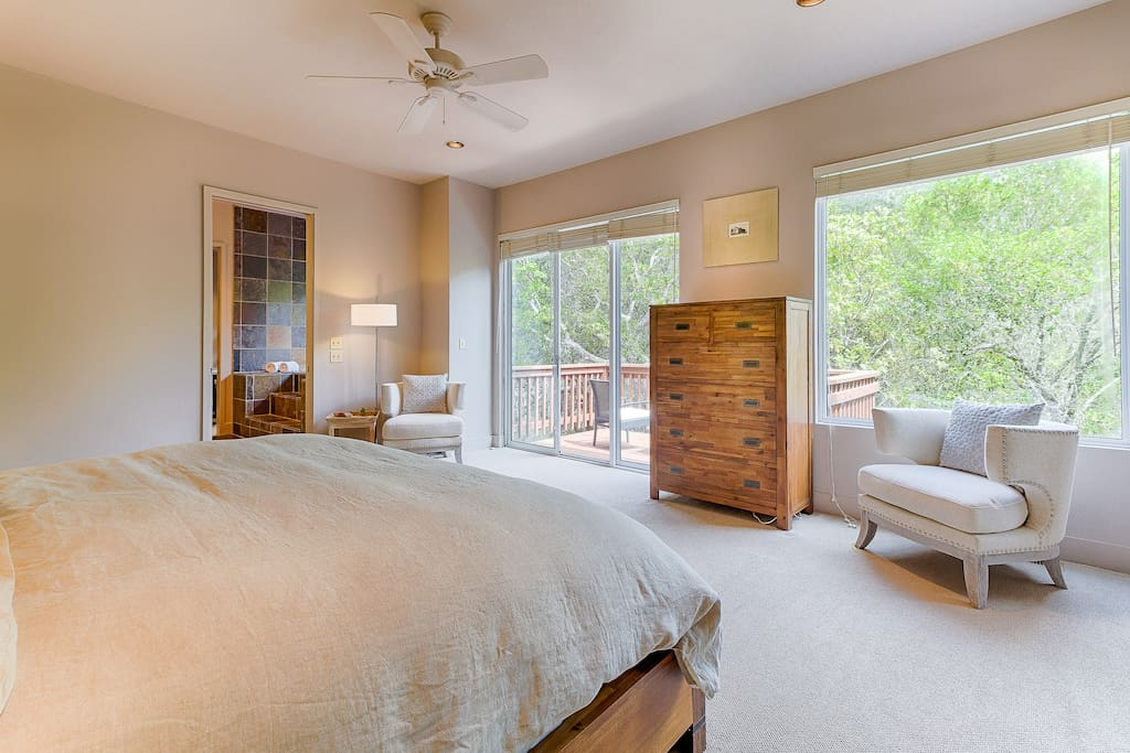 It comes with a king bed, sitting area, and sliding doors that lead out to a private balcony.