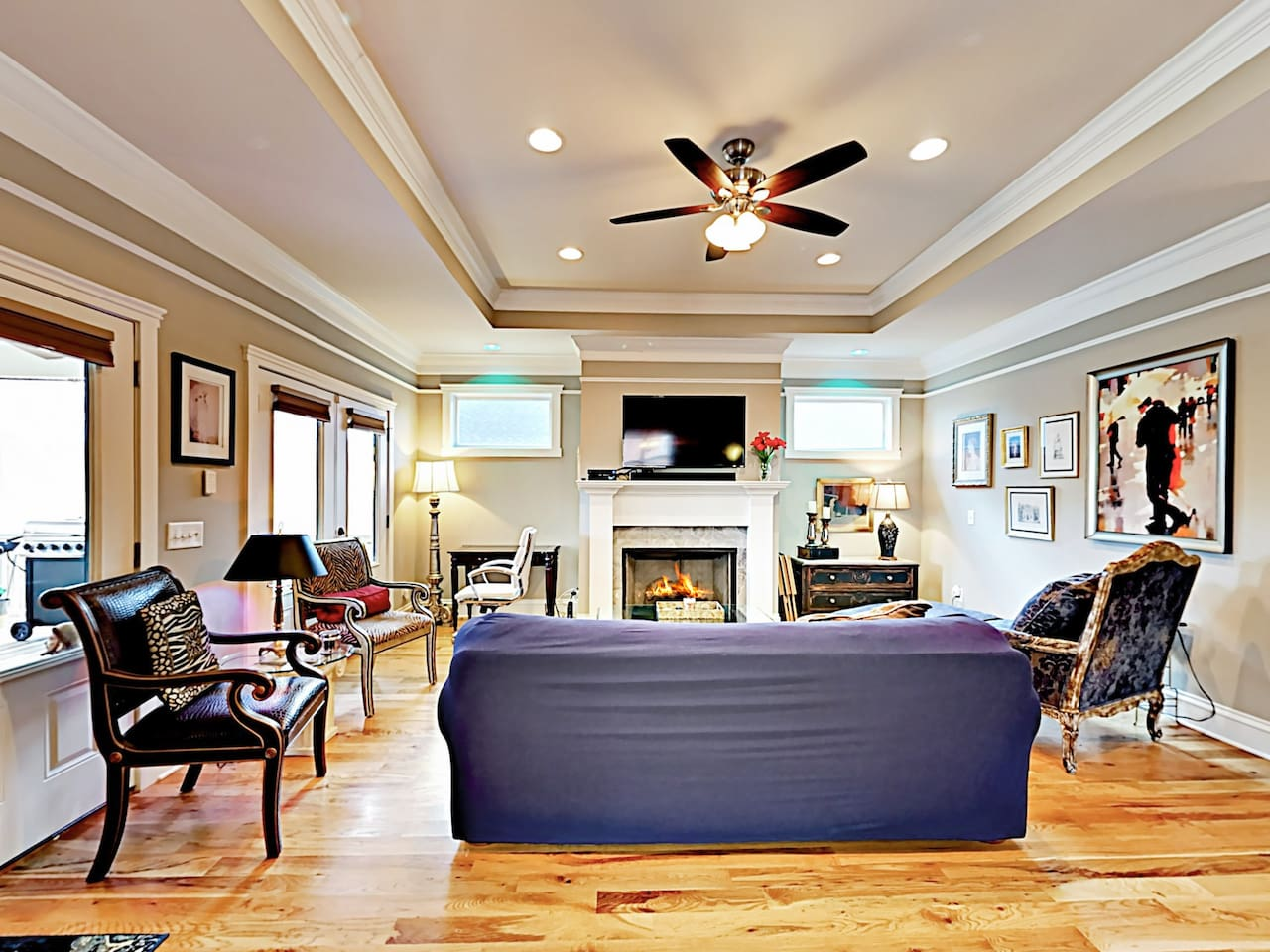 The living room offers comfortable seating for pre-dinner drinks or unwinding with a movie.