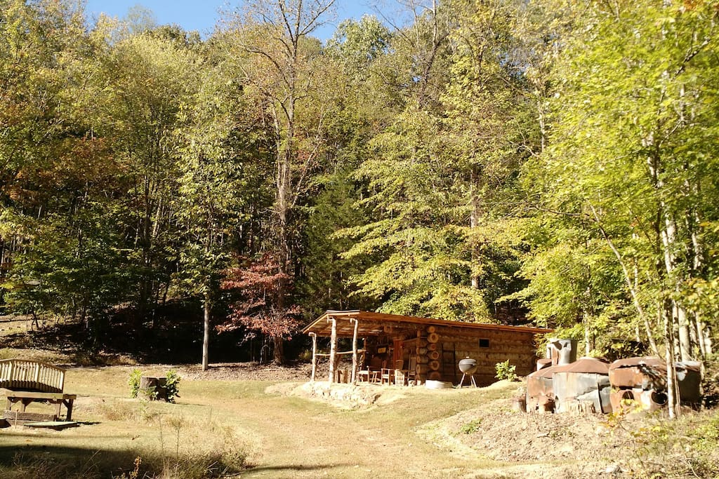 Settled in next to an authentic (retired) moonshine still, small bridge over a watershed creek, in proximity to a pavilion, and other small non-occupied structures that gives the feel of an old time settlement.