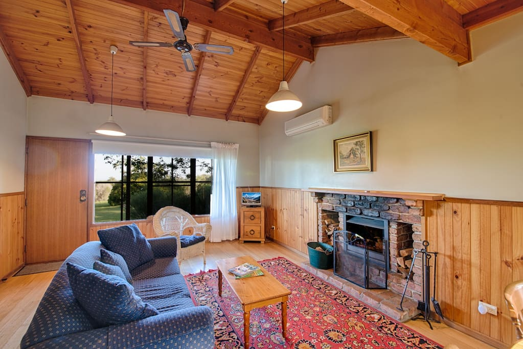 Murray's large living area with open fire.