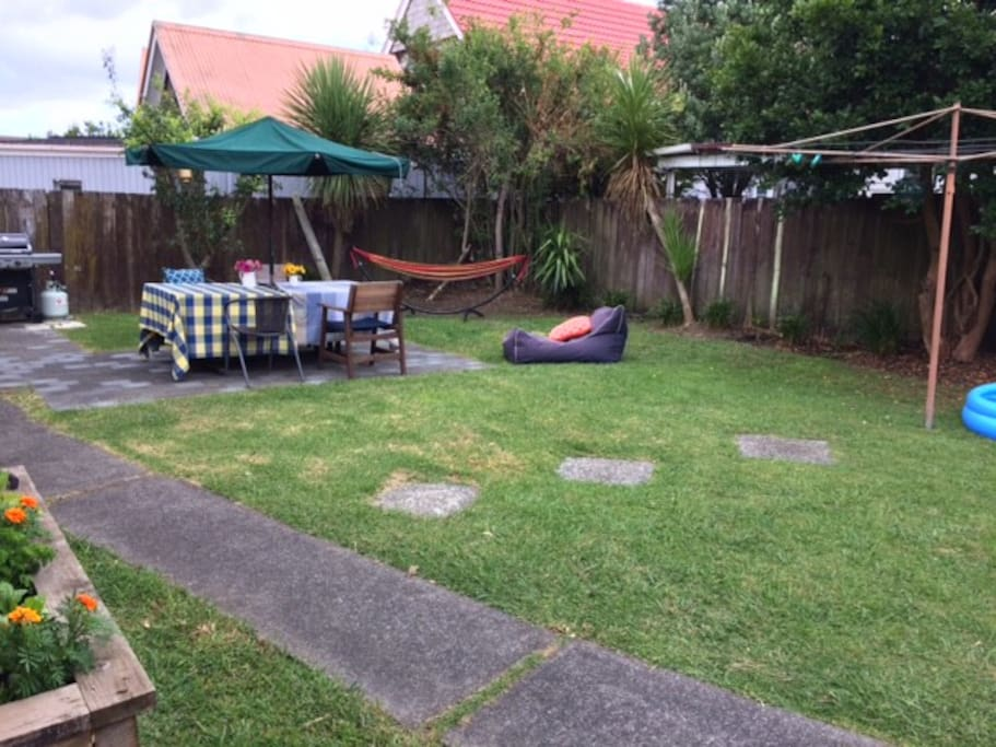 Large back yard, perfect for dinners/BBQ on those beautiful days. Space for kid and a veggie garden.