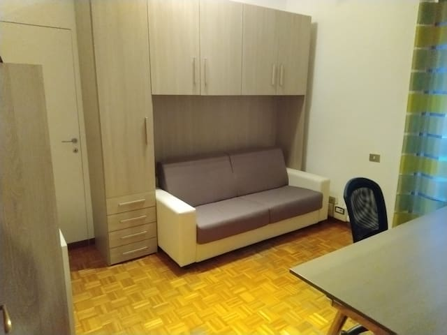 Double room with shared bathroom and kitchen
