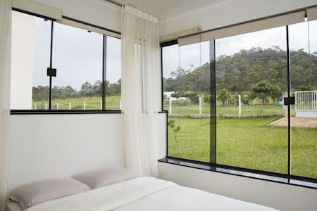 Suíte externa da casa da Indaiá - Alto Paraíso de Goiás - Casa