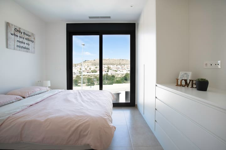 Bedroom with panoramic views on the first floor. There is an on-suite with underheated floor.