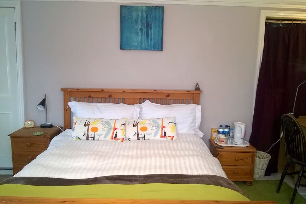 Large comfortable bedroom with King-size bed. Tea making facilities, towels, water, .Great quality sprung mattress and Egyptian cotton linen.