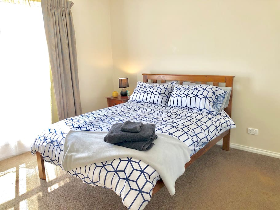 Large spacious main bedroom with cot