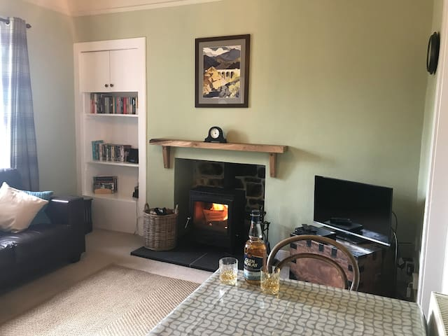 Cosy living room with dining area. Relax with a dram in front of the log burner.
