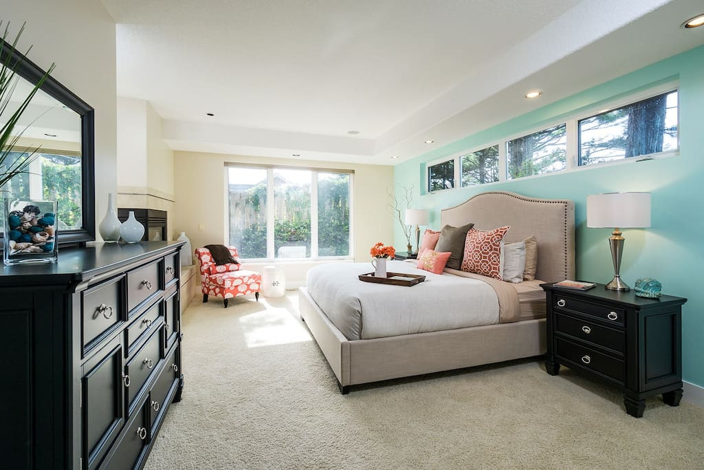 First floor master bedroom suite (king-sized pillow top bed, double-sided fireplace, en suite spa bathroom)