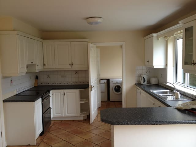 Kitchen and Utility with dishwasher, washing machine and dryer