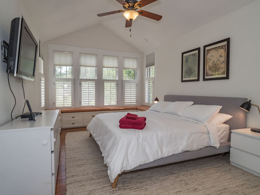 Master bedroom with a king bed and cable tv