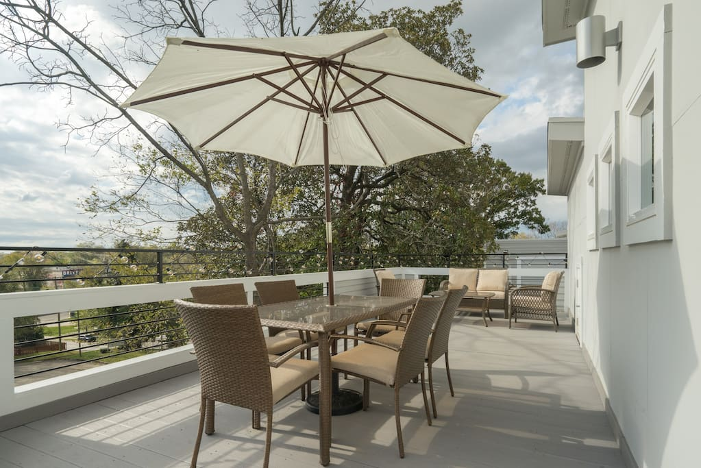 Seating for 10 on the private roof deck with al fresco dining and wicker sitting area.