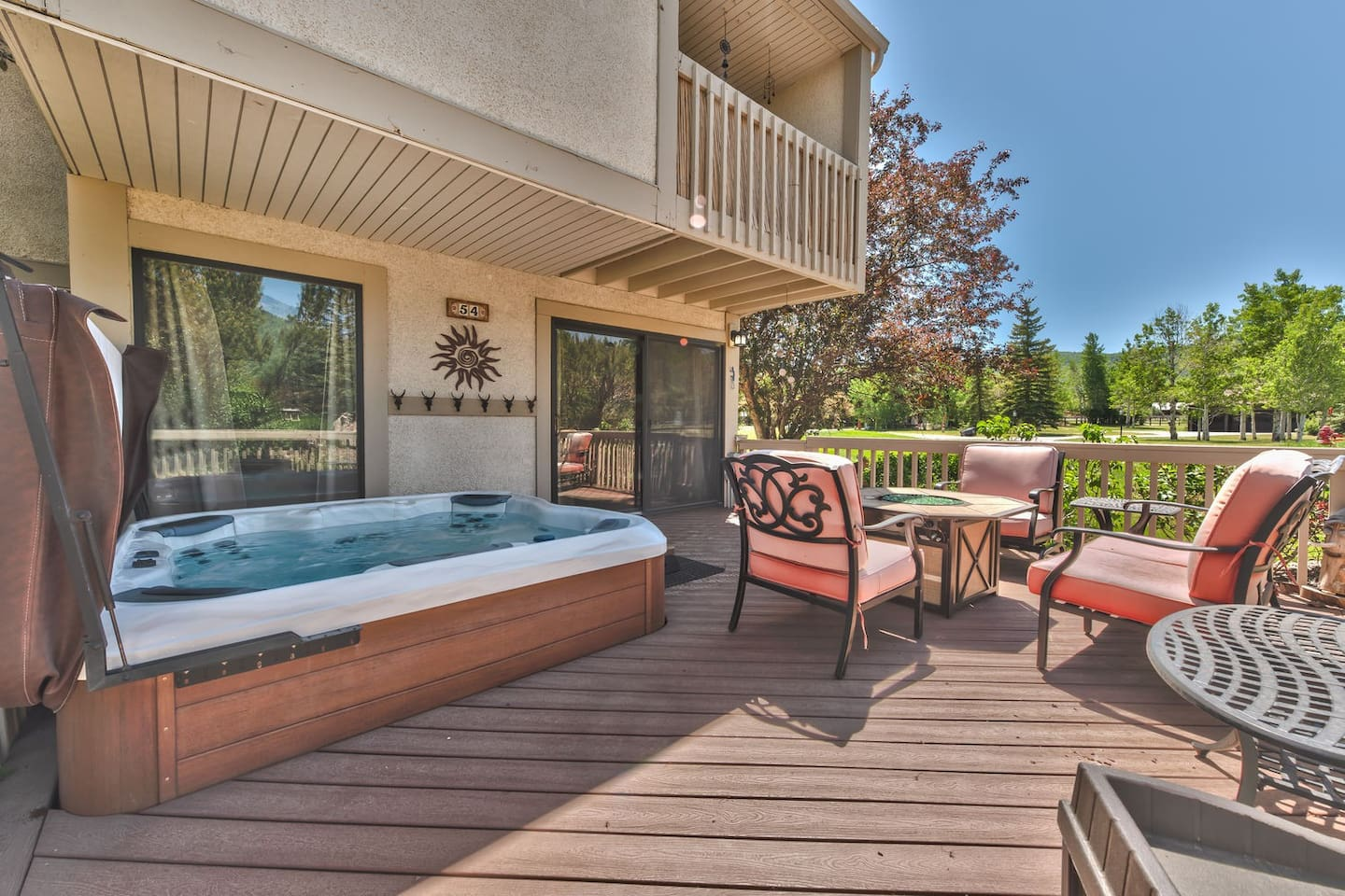 Large deck with comfortable seating, and 8 person Bullfrog Hot Tub