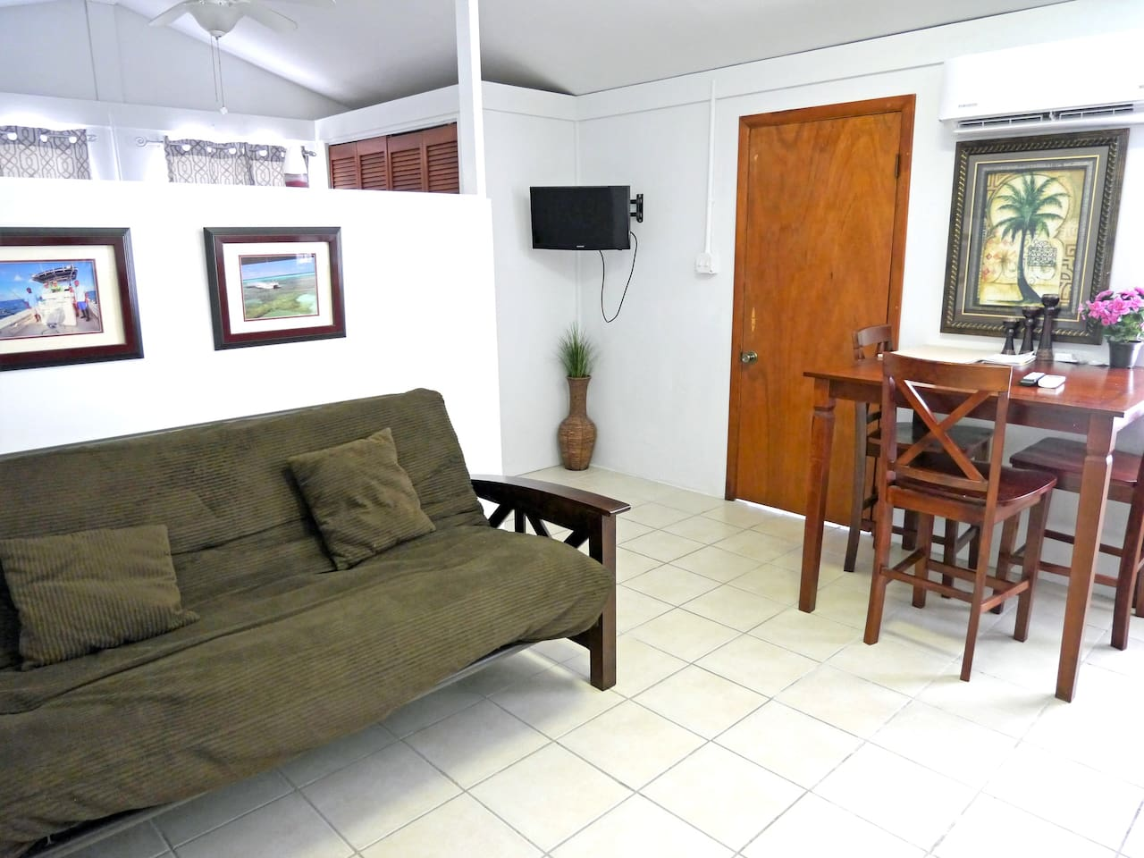 Comfortable, cozy, accommodation with wall mounted Smart TV, full size Futon Sofa bed and Split Unit AC.