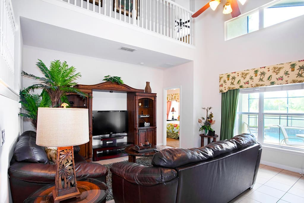 Luxurious living area with 52-inch LCD TV, DVD/VCR combo & CD shelf stereo system