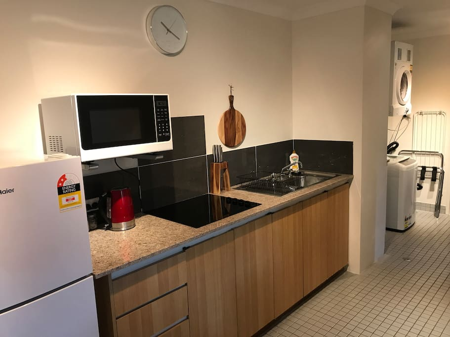 Newly renovated kitchen with new granite bench, cooktop and all cooking essentials and utensils