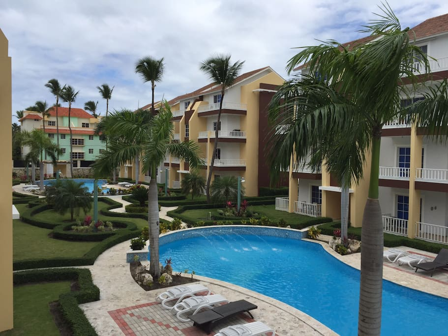 View of pools and beautiful gardens from your own private lanai