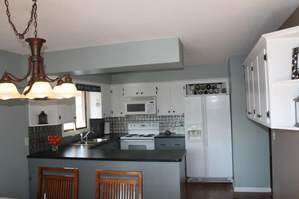 Stove/oven, Dishwasher, Microwave.  Attached Dinning room seats 6