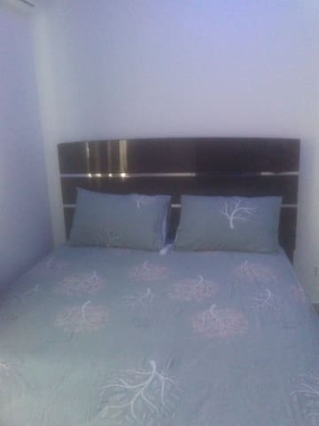 Queen bed in room 4 also out fitted with A.C unit and storage space ..