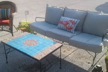 Relaxing private back patio area weather permitting and seasonal.