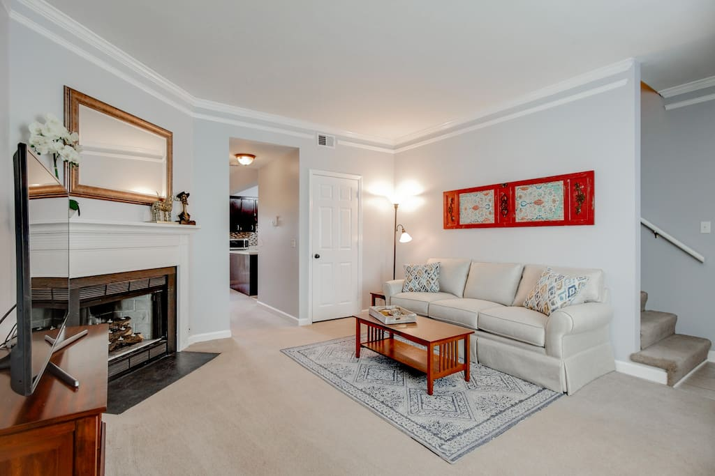 An ornamental fireplace lends grace to the room