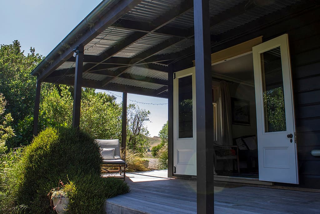 Enjoy indoor/outdoor living. The rooms all open onto the verandah, on which there's also a dining table and BBQ.