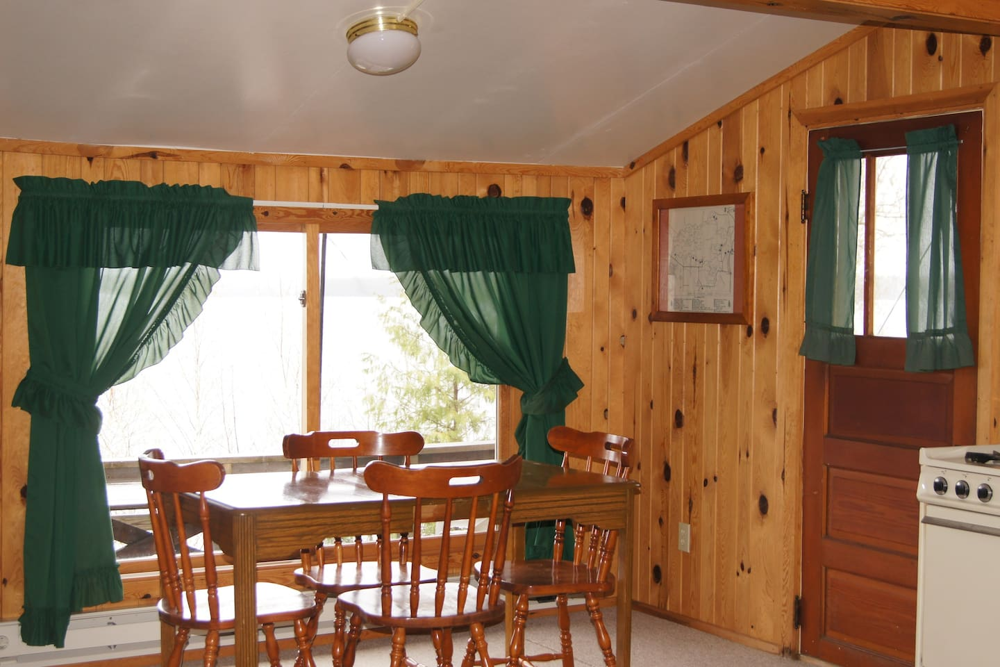 Kitchen/Dining area with Beautiful view of Pelican Lake