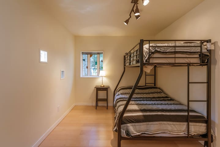 The second bedroom has a double and single bed.