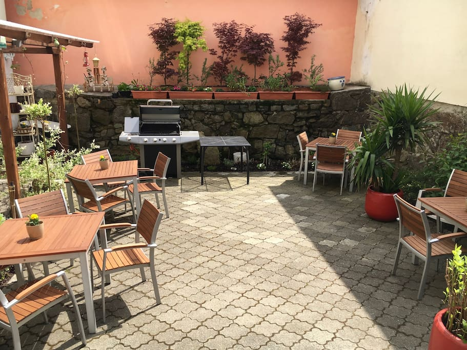 Private backyard with barbecue grill and seatting.