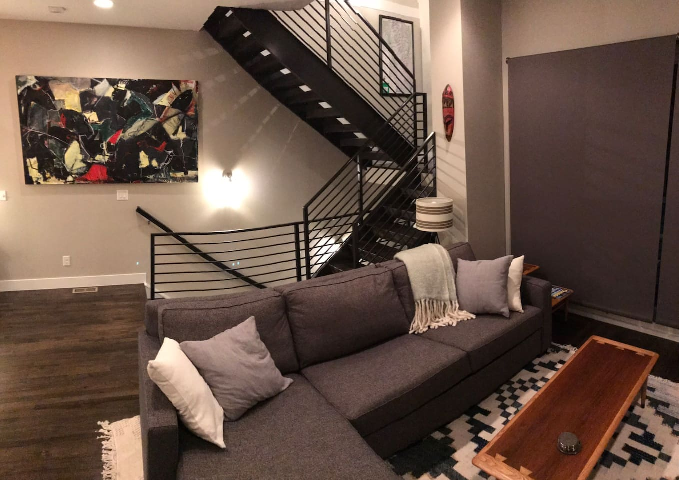 Living area and open staircase the Art was done by a friend!