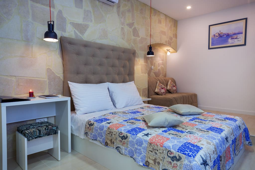 The bed is made of memory foam, there is also a desk for You to use should You need to do any business while away.