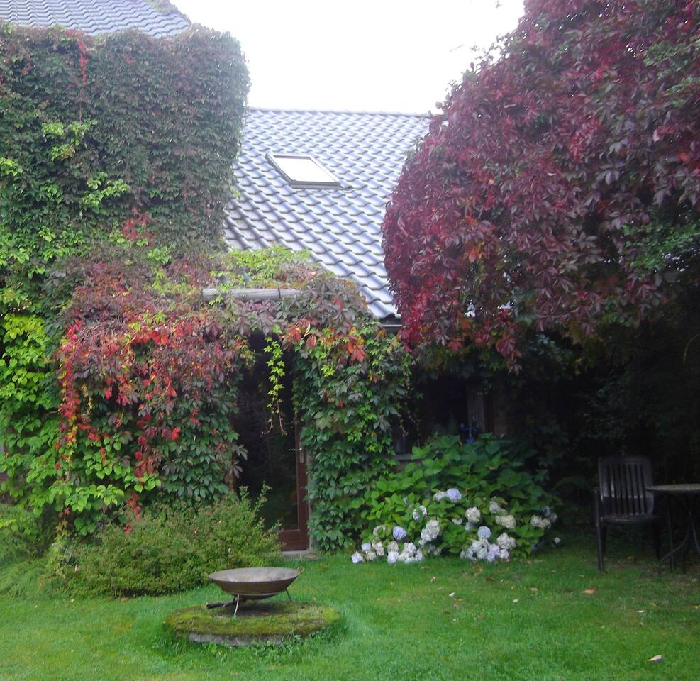 Studio in the restored stable - entrance from the garden