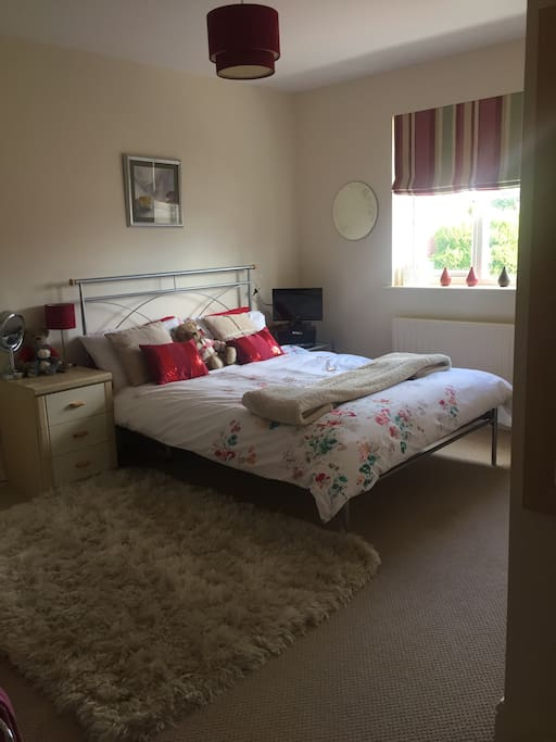 Spacious double bedroom with plenty of space to relax and spread out. Small tv, but you are welcome to use the living room where there is a full size television.