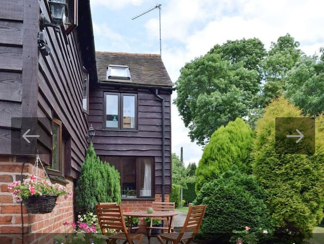 A quiet,relaxing patio area set in a large lawned garden. Small stream/ditch runs along the length of the garden.