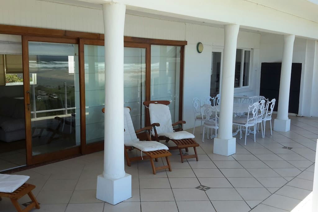 Spacious patio with inbuilt braai and weber.