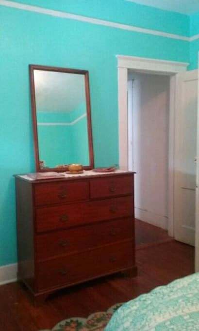 Bedroom has new double mattress, dressers and mirror.