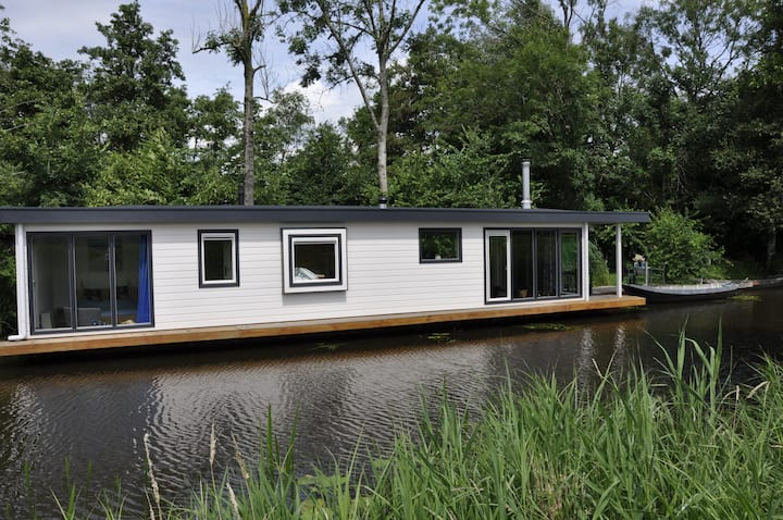 Houseboat on the picturesque location on the water