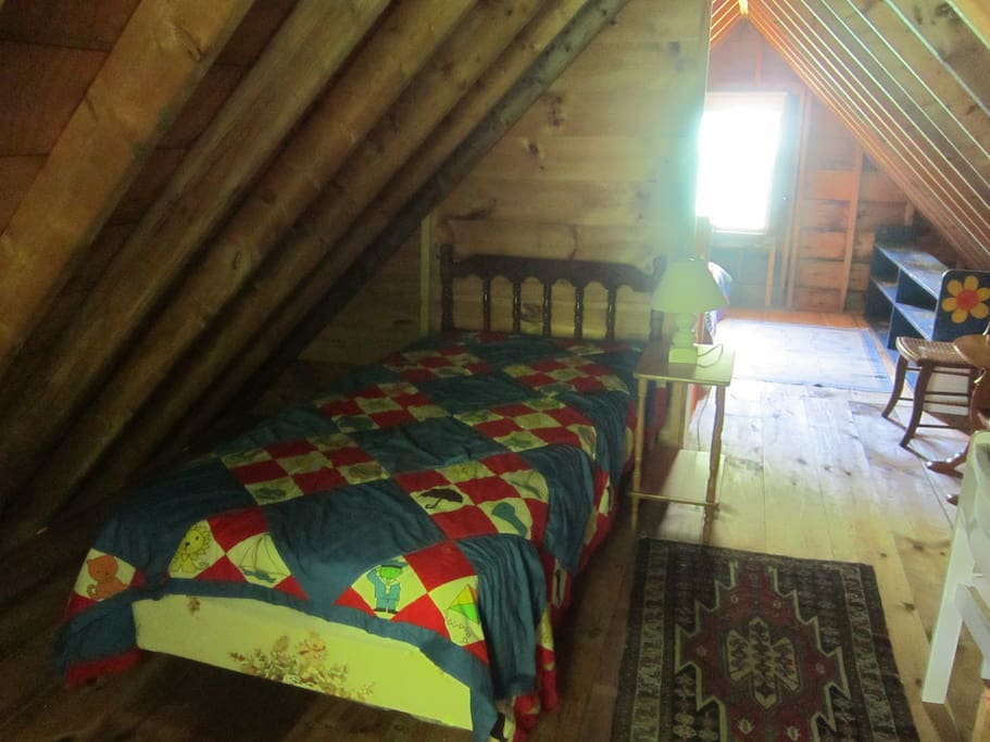 Twin bed in other half of sleeping loft.