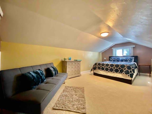 Second floor bedroom. 1 Queen bed plus futon.