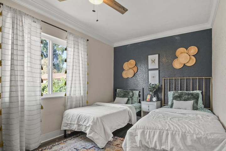 Two twin beds with a stylish backdrop.