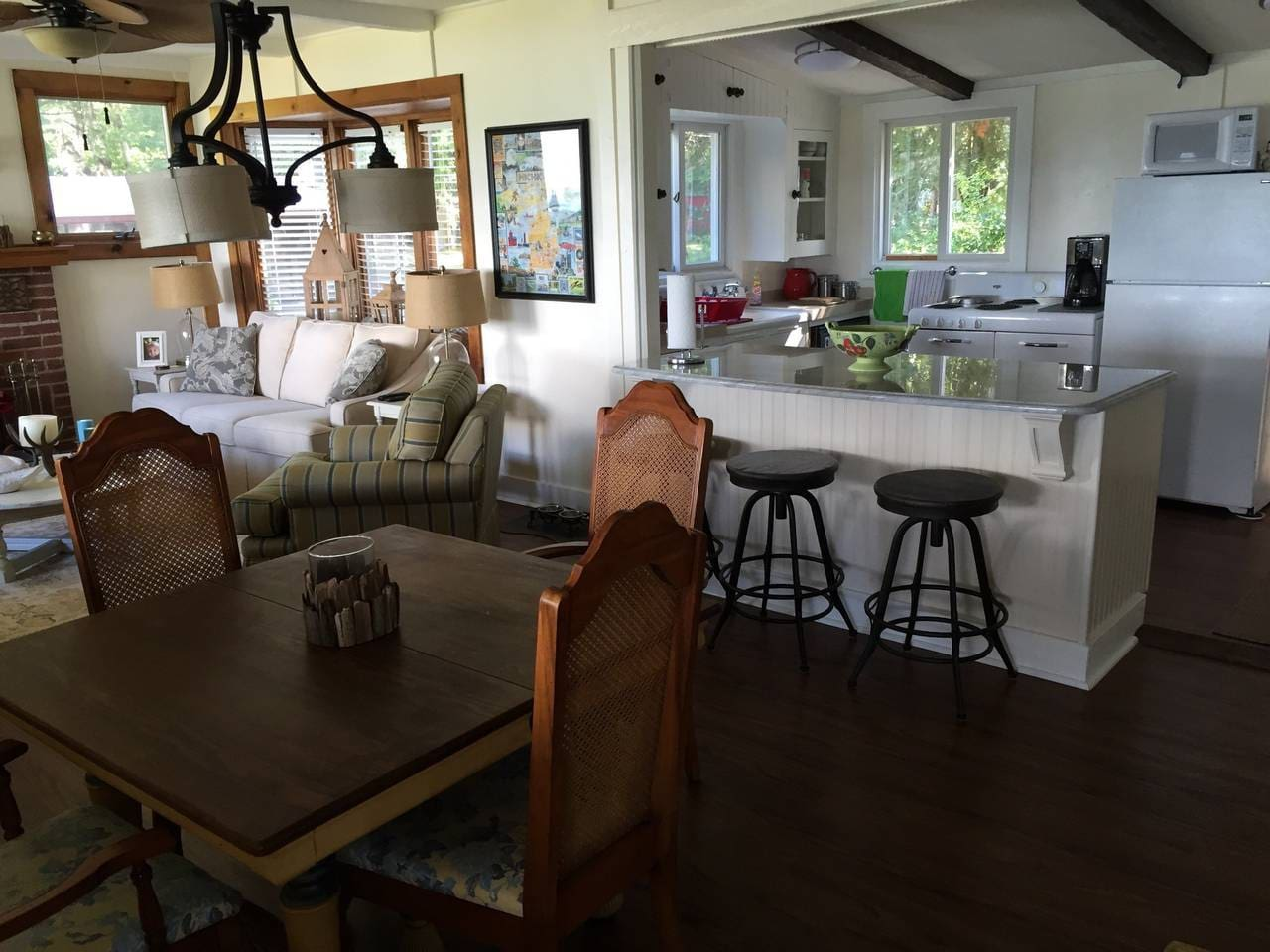 The cottage has an open floor plan with the living room, dining area and kitchen together.