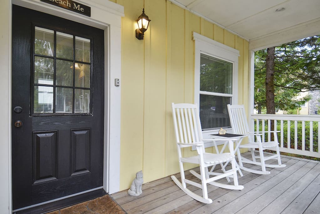 A welcoming front porch with a few rocking chairs to enjoy the outside weather.