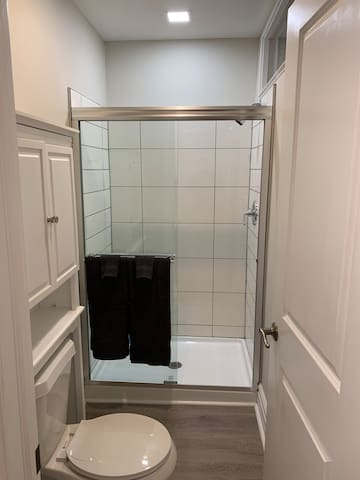 Private bathroom with porcelain tile shower