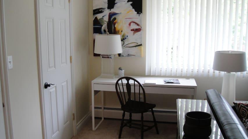 Desk area in living room, large closet