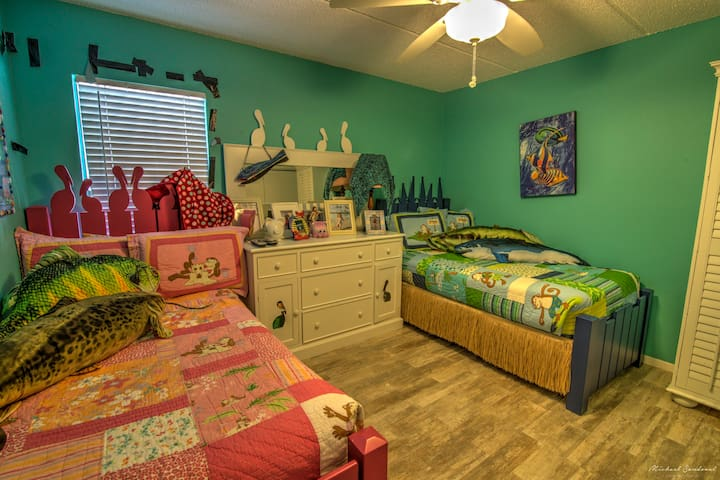 """Two twin beds with pillow toppers offer comfortable sleeping. Or a place to watch cable tv on the 30"""" smart tv. This room includes a washer and dryer located inside the closet to wash away the sand! With a full bath just listed it's doors."""