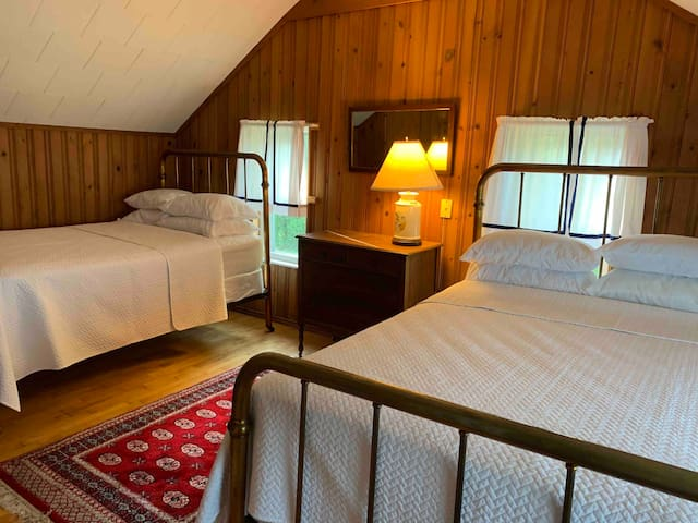 Bedroom number one has two full-size beds and bath.